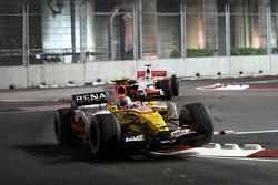 Nelson A. Piquet, Renault F1 Team, R28 leads Adrian Sutil, Force India F1 Team, VJM-01