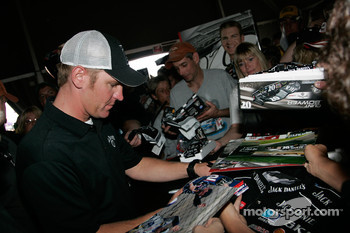 Clint Bowyer signs autographs for fans