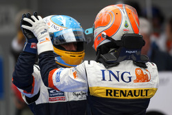 Race winner Fernando Alonso celebrates with Nelson A. Piquet