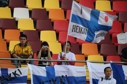 Heikki Kovalainen, McLaren Mercedes flag and fan