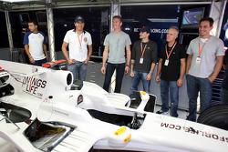 Stock Car driver Carlos Bueno, David Coulthard and Stock Car driver Daniel Serra and guests in the Red Bull Racing garage
