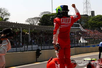 Pole winner Felipe Massa celebrates