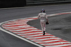 David Coulthard, Red Bull Racing walks back to the pits after crashing out of his final GP