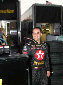 Juan Pablo Montoya smiles after his wreck with David Gilliland