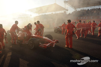 Felipe Massa and Kimi Raikkonen celebrate with burnouts