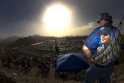 A Jimmie Johnson's fan watches the race