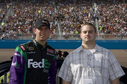 Denny Hamlin poses with a guest