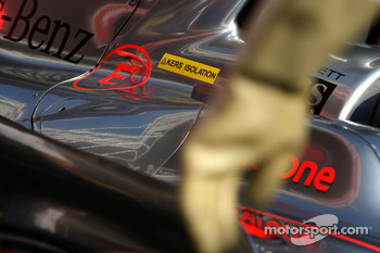 Gary Paffett, Test Driver, McLaren Mercedes, sticker for KERS and the rubber glove from a mechanic