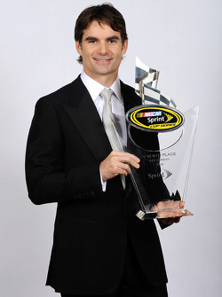 Jeff Gordon poses with his award for seventh place in the NASCAR Sprint Cup Series Chase