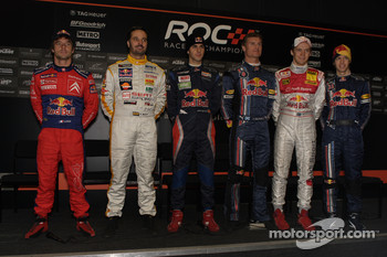 Red Bull drivers Sbastien Loeb, Yvan Muller, Jaime Alguersuari, David Coulthard, Mattias Ekstrm and Sebastian Vettel pose for a photo