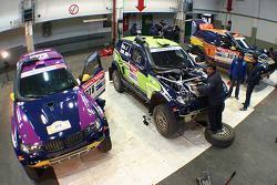 X-raid team: the #330 BMW X3 CC of René Kuipers and Filipe Palmeiro, the #302 BMW X3 CC of Nasser Al Attiyah and Tina Thorner, the #318 BMW X3 CC of Peter van Merksteijn and Eddy Chevaillier in the garage