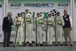 GT victory lane: class winners Jorg Bergmeister, Andy Lally, Patrick Long, Justin Marks and RJ Valentine celebrate with Brian Redman
