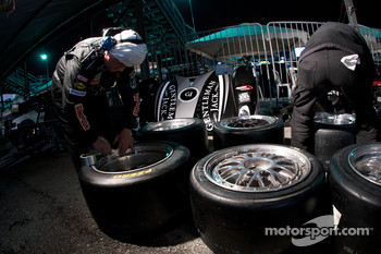 Childress-Howard Motorsports team members prepare tires