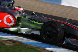 Heikki Kovalainen, McLaren Mercedes, MP4-24, with green dye on the side of the car