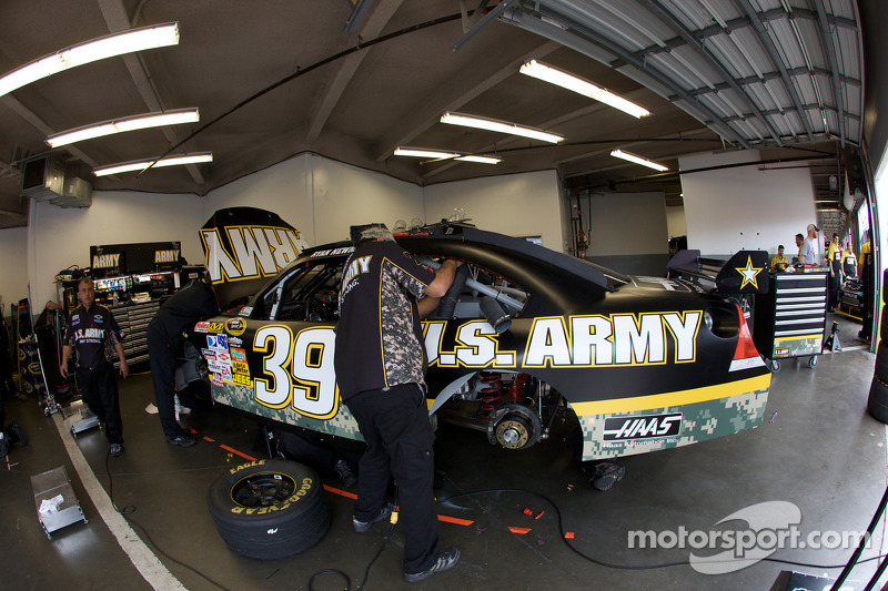 Stewart-Haas Racing Chevrolet work on the car of Ryan Newman