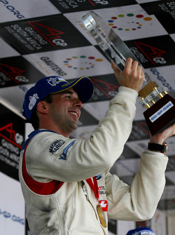 Podium: race winner Neel Jani celebrates