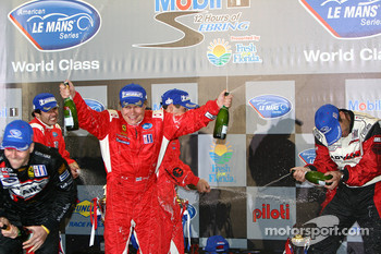GT2 podium: Mika Salo sprays champagne with two bottles