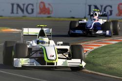 Rubens Barrichello, Brawn GP leads Kazuki Nakajima, Williams F1 Team, FW31