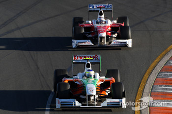 Giancarlo Fisichella, Force India F1 Team leads Jarno Trulli, Toyota Racing, TF109