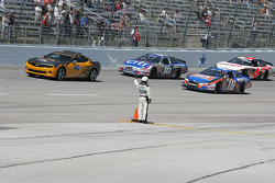 A NASCAR official signals one lap to go