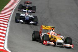 Nelson A. Piquet, Renault F1 Team leads Kazuki Nakajima, Williams F1 Team