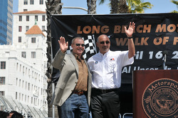 Bobby Rahal and Al Unser Jr. wave to the crowd