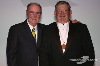 NASCAR Vice President of Corporate Communications Jim Hunter presents former NASCAR Sprint Cup Series driver Donnie Allison with his International Motorsports Hall of Fame medal