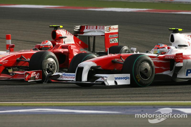 Kimi Raikkonen, Scuderia Ferrari and Timo Glock, Toyota F1 Team