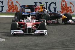 Jarno Trulli, Toyota F1 Team and Sebastian Vettel, Red Bull Racing
