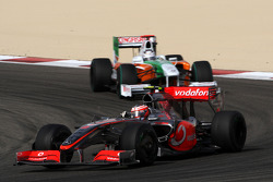 Heikki Kovalainen, McLaren Mercedes leads Adrian Sutil, Force India F1 Team