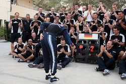 Red Bull Racing celebration: Sebastian Vettel celebrates second place finish with Christian Horner and Red Bull Racing team members