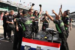 Panther Racing team members celebrate as Scott Sharp qualifies