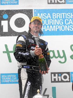 James Thompson sprays champagne after victory