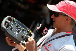 Heikki Kovalainen, McLaren Mercedes shows his steering wheel