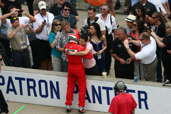 Helio Castroneves celebrates winning the pit stop challenge