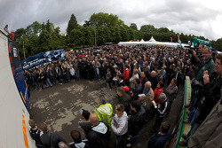 Fans wait for the Team Peugeot Total Peugeot 908 cars to unload