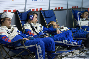 Team Peugeot Total team members take a nap between pit stops