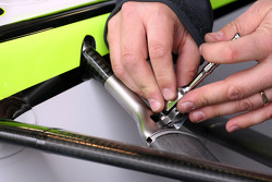 A mechanic works on the suspension of Jenson Button, Brawn GP