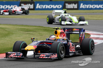 Sebastian Vettel, Red Bull Racing leads Rubens Barrichello, Brawn GP