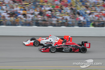 Helio Castroneves, Team Penske and Justin Wilson, Dale Coyne Racing run together