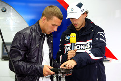 Lukas Podolski visits the garage of BMW and talks with Robert Kubica, BMW Sauber F1 Team