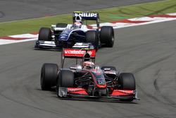 Heikki Kovalainen, McLaren Mercedes leads Kazuki Nakajima, Williams F1 Team