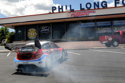 Ford Fiesta driver Marcus Gronholm has some fun in the Phil Long Ford parking lot prior to a press conference in Colorado Springs