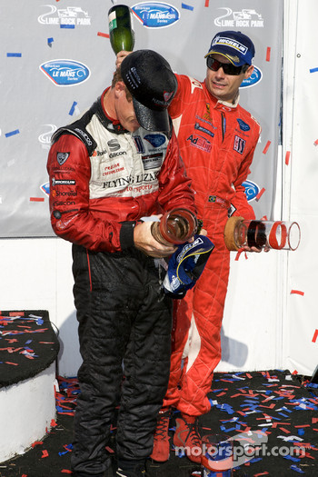 GT2 podium: Patrick Long and Jaime Melo celebrate with champagne