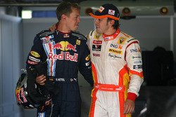 Pole winner Fernando Alonso, Renault F1 Team, with second place Sebastian Vettel, Red Bull Racing