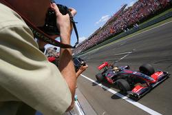 Lewis Hamilton, McLaren Mercedes, takes the checkered flag