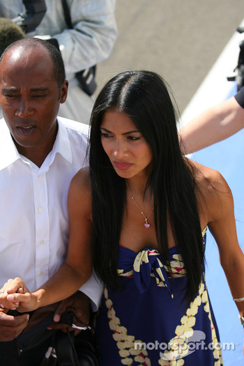 Anthony Hamilton, Father of Lewis Hamilton with Nicole Scherzinger, Singer in the Pussycat Dolls and girlfriend of Lewis Hamilton run to the podium