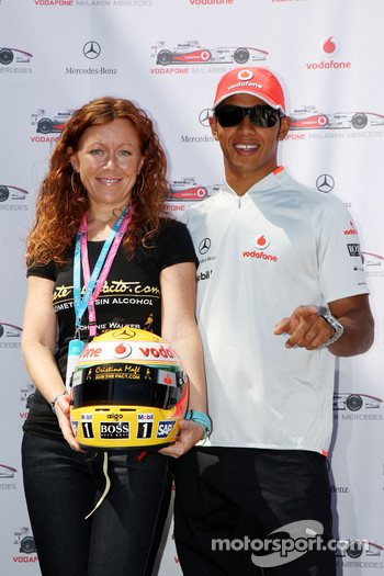 Lewis Hamilton, McLaren Mercedes, helmets have the name of Johnny Walker prize winners