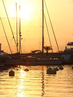 Sun rises above the port