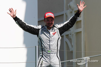 Podium: race winner Rubens Barrichello, BrawnGP celebrates
